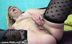Horny mature housewife spreads her pussy