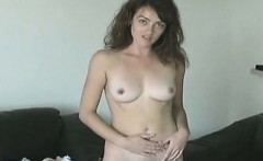 Teen brunette does a softcore striptease