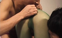 Hottie in green nylon masturbation by two bally shafts