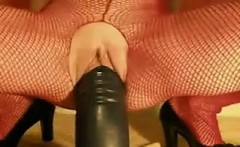 slut riding a big black dildo