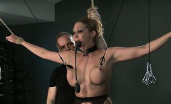 Tied up busty blonde pussy toyed in dungeon