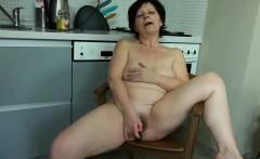 Granny mature masturbate with orange dildo