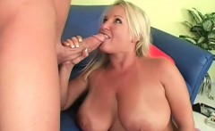 Slutty mom gives titjob on the couch