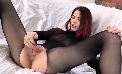 Petite babe Lovenia pleasures herself with a massive dildo