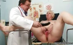 Blonde grandma gets her pussy examed