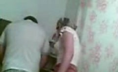 Hidden cam in the bathroom shows a blonde babe getting her