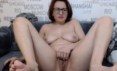 Geeky MILF redhead spreads her legs to finger her shaved pu