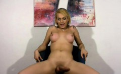 Latina t-girl in jeans skirt reveals boobs and shaved dick