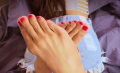 Footfetish tattooed ladyboy displays her feet