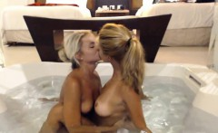 young blondes get in the hot tub to play