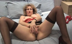 classy mature lady fingering in stockings