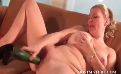 Nasty mom nails her snatch with a cucumber
