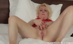 Blonde mature spreads wide her pussy