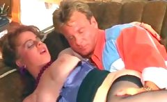 Cute brunette MILF with big tits blows