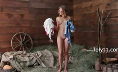 Young subtle babe teasing in barn