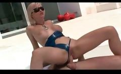 Tarra White in blue latex and sun glasses fucked outdoors