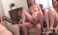 Cock riding and pussy rubbing in orgy with matures