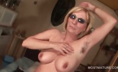 Kinky mature in glasses working her old cunt from behind
