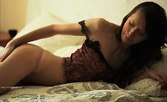 True Russian model on the bed