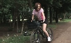 Japanese teen cutie rides bike with a dildo up in her cunt
