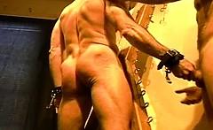 Huge bodybuilder's muscle butt gets an ass whuppin' as only