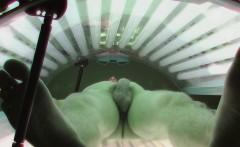Young man secretly filmed in public solarium