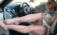 Lady Showing Off Her Nylons From The SUV
