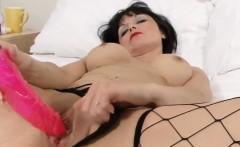 Mature Slut In Fishnets Masturbating