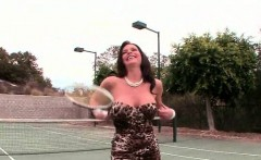 Gorgeous MILF flaunting sexy tits on tennis field