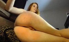 Redhead is on her webcam and shows off her ass and clam hol