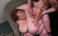 Fat redhead lady with massive breasts knows how to please a big dick