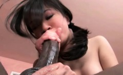 Sweet young Asian gets her mouth and tight bald pussy invaded by a huge black cock
