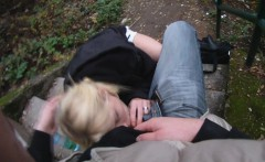 Young blonde babe gives a blowjob and gets nailed from behind on the stairs