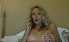 Attractive blonde milf on telephone stripteasing and talkin