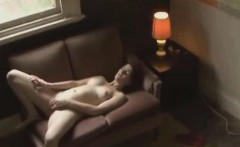 Redhead fingering on couch