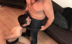 Restrained with a belt and rope boy gives oral job