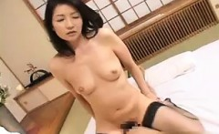 Buxom Japanese milf in stockings satisfies her desire for y