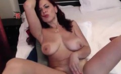 Brunette with big boobs masturbates