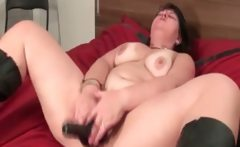 Horny busty mature babe penetrates her