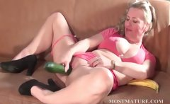 Dirty mature fucks snatch with a cucumber