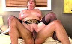 Milf in lingerie massages her lover