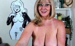 Blonde mature with big boobs masturbates in bed