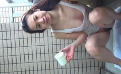 Japanese babe pees in cup