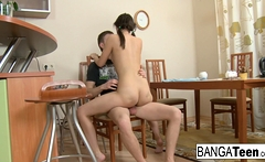 Young brunette gets fucked and creampied on the table