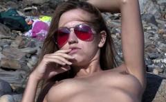 Longlegged blondie modeling naked on the beach