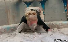 Sexy blonde gets covered in dirty mud