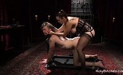 Slave gets his asshole strapon-fucked