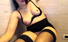 Sexy busty big tit milf in stockings masturbates on webcam