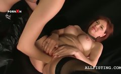 Lesbo mature in stockings gets fist fucked hardcore