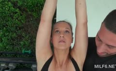Sexy MILF in tight outfit seducing her fitness trainer